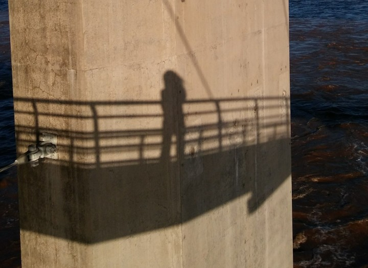 my shadow on a bridge pier