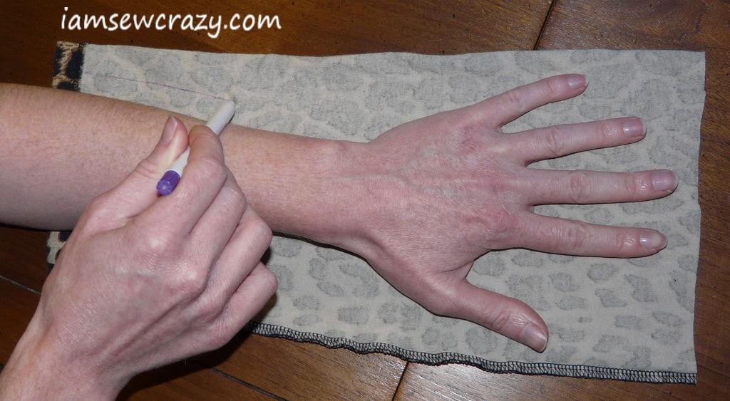 tracing my hand onto the fabric