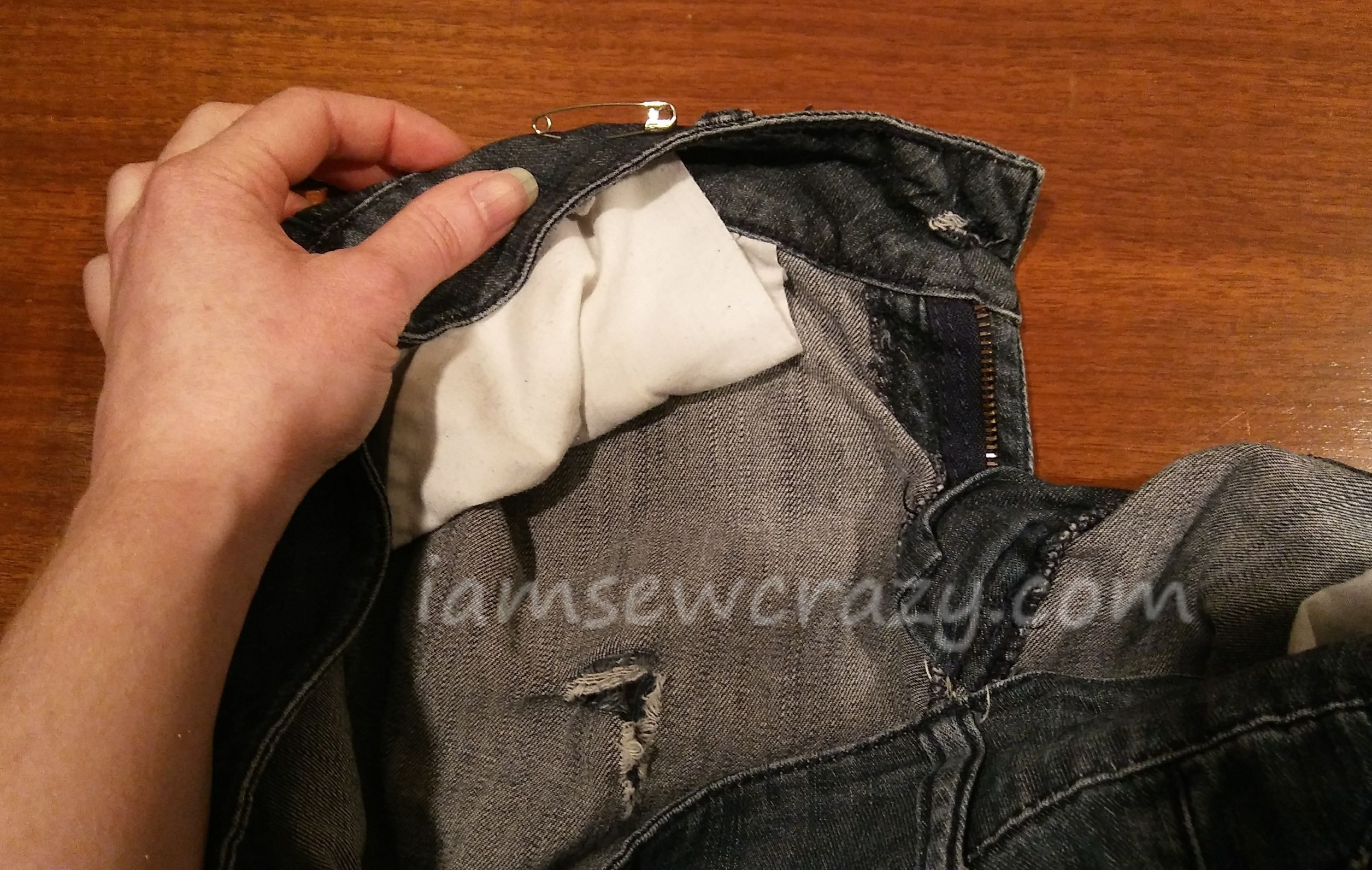 patching torn jeans