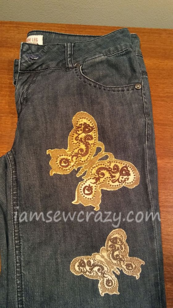sewing patches on jeans