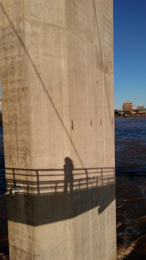 my shadow on a bridge pier