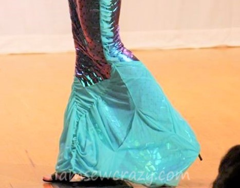 The mermaid dress had a tulle-covered fin at the bottom, that was designed to flare out when the model stood still, and flex when she walked on the fashion show runway.
