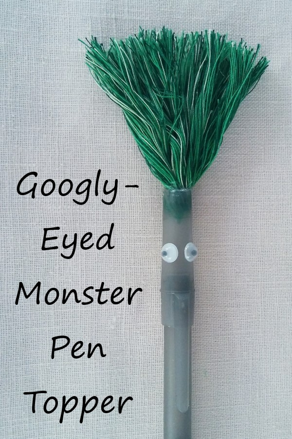 Googly-eyed monster pen topper