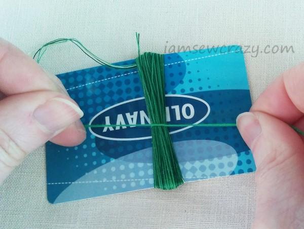 knotting thread around thread bundle