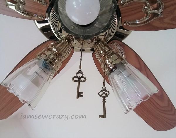 skeleton keys hanging from a ceiling fan