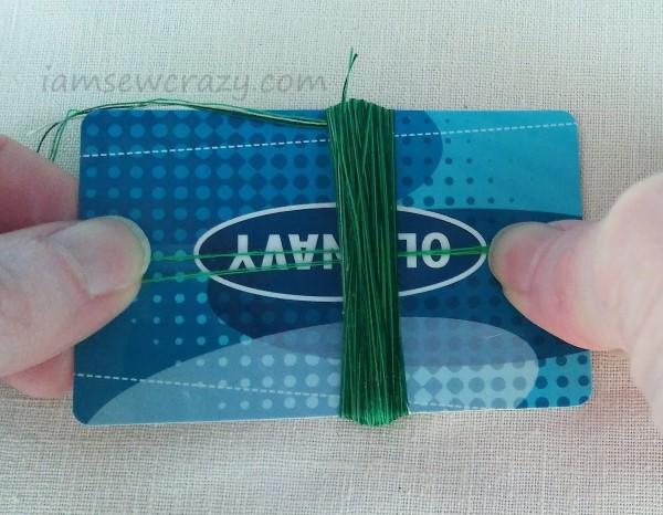 tying thread around a bundle of threads