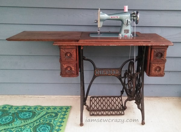 vintage sewing machine in treadle table