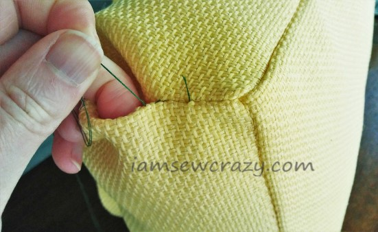 closing the opening of the pillow with hand stitches
