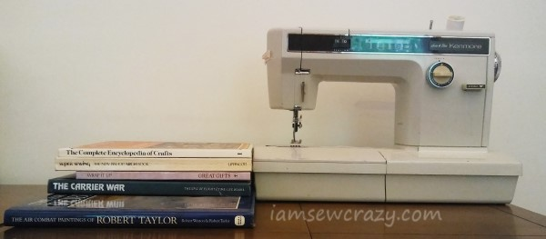 stack of books next to sewing machine