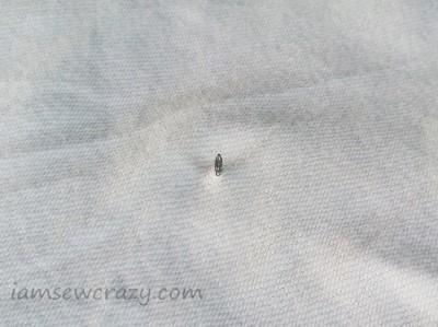 thumbtack in fabric
