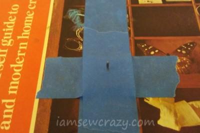 thumbtack taped to books