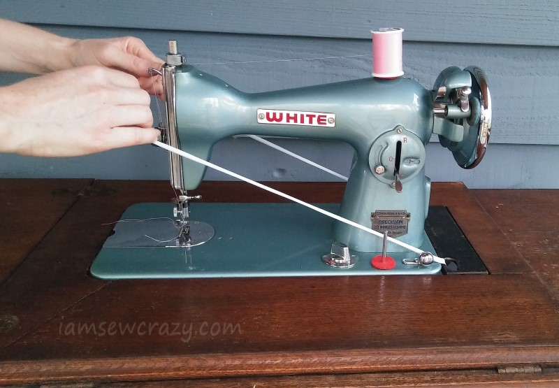 stretching a treadle belt over the machine