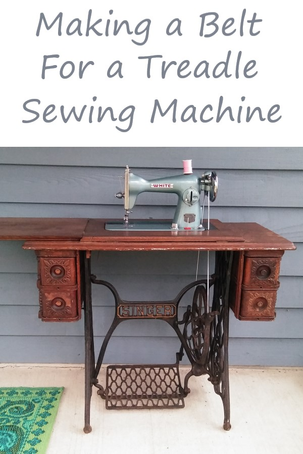 blue vintage sewing machine in treadle table with text overlay: making a belt for a treadle sewing machine