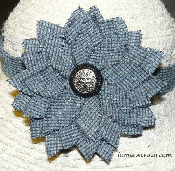 blue flower on sun hat