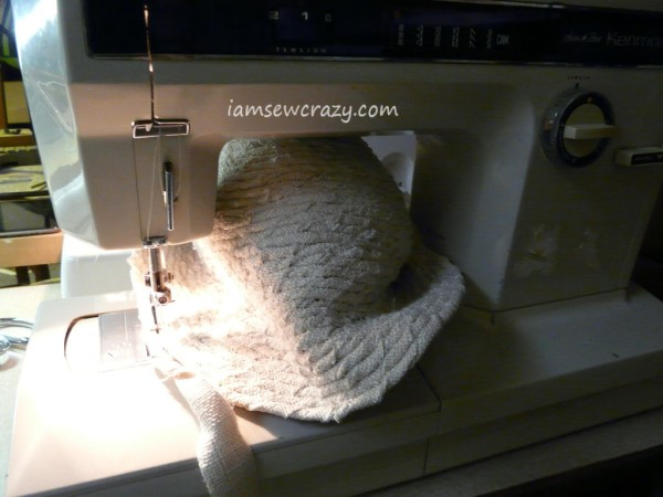 hat squashed under the sewing machine