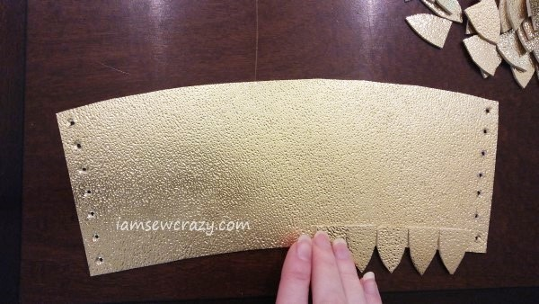 gluing gold dragon scales to arm cuff