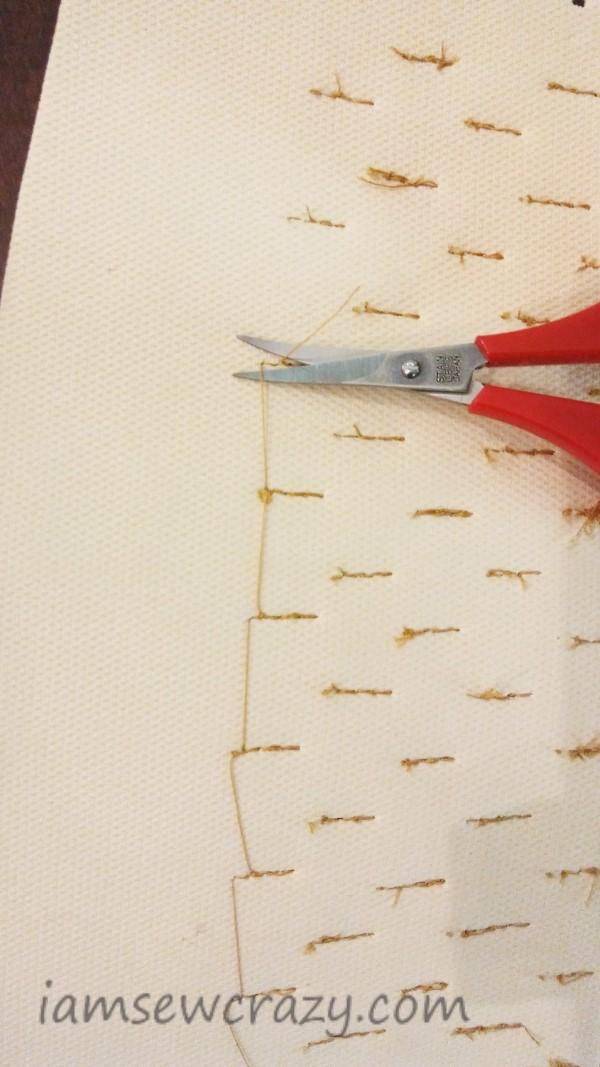 cutting jump stitches on back of dragon scale arm cuff