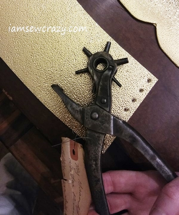 punching holes to lace-up arm cuff