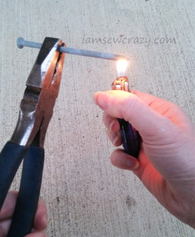 heating a nail with a flame