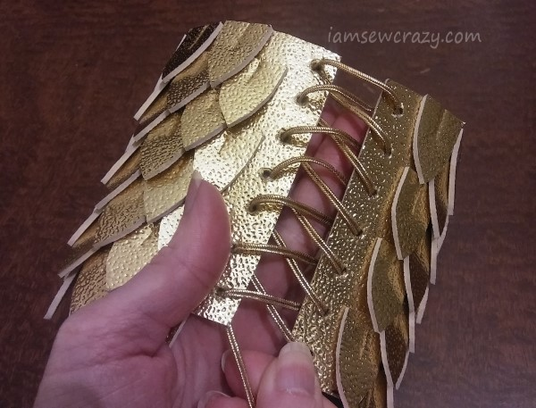 lacing up dragon scale arm cuff