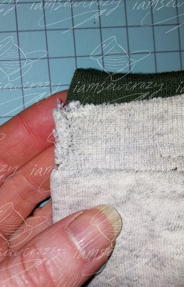 worn corner of sweatshirt collar
