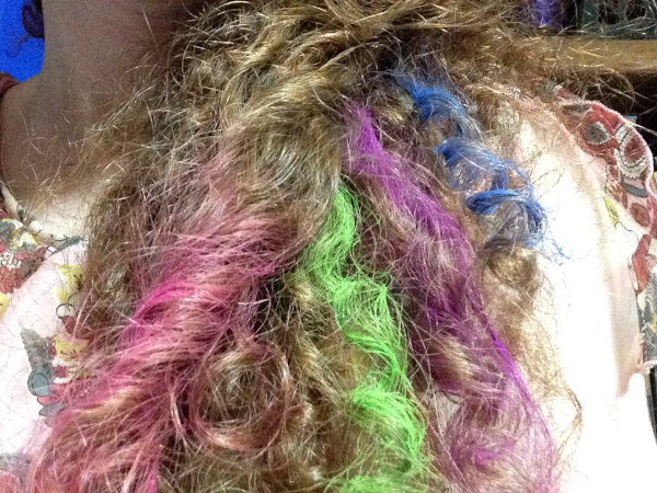 pink, green, purple, and blue hair chalk in curly red hair