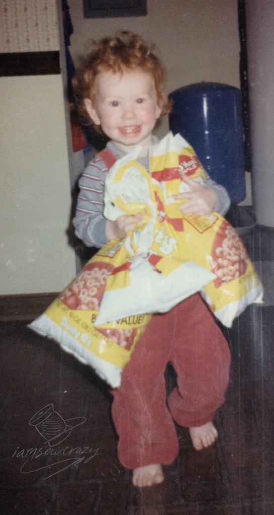small child holding bags of cereal