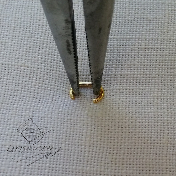 spreading jump ring with pliers