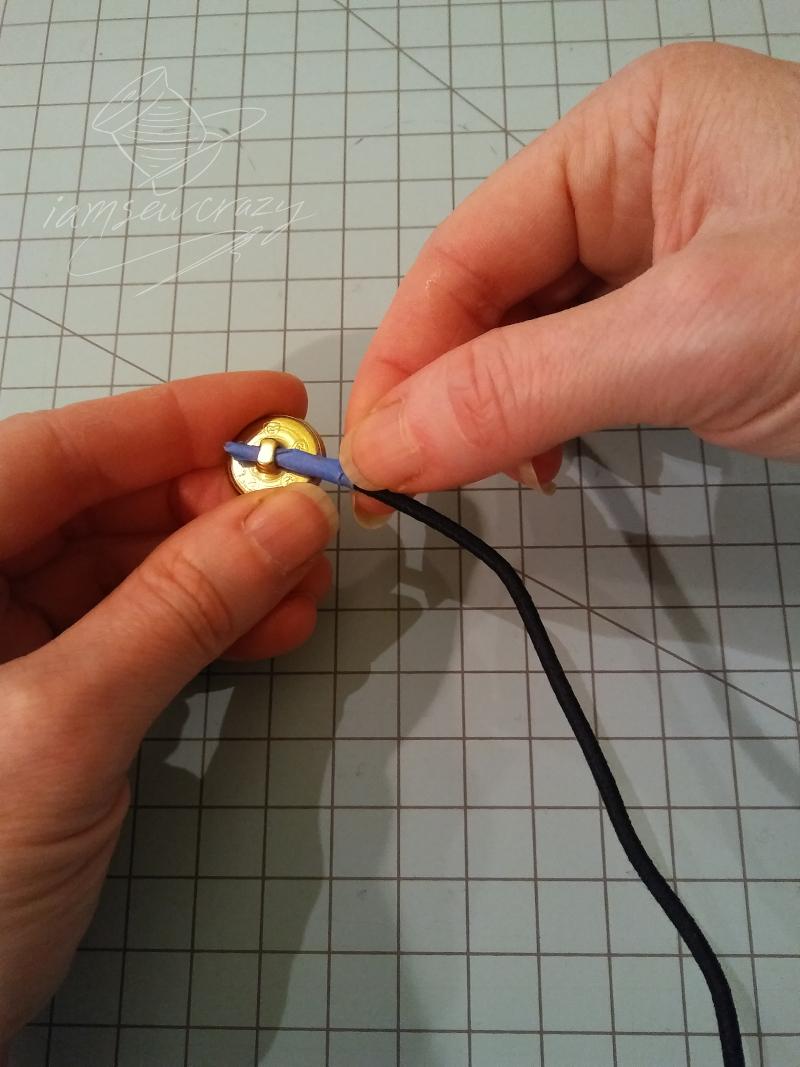 threading cord through buttonhole