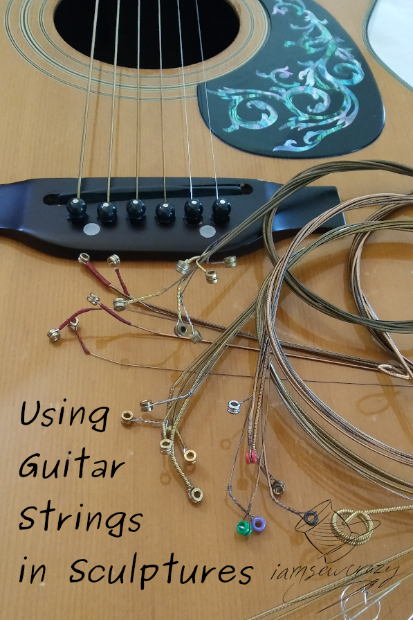 guitar body with abalone decal and text overlay: using guitar strings in sculptures