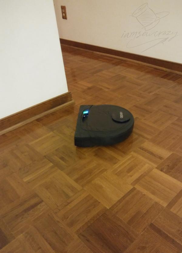 robot vacuum on parquet floor
